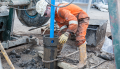Workman working at a borehole site