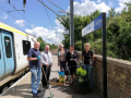Group on Meldreth Station platform with train in background