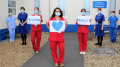 Doctors and nurses spell out the word' thank you'