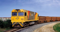 An Aurizon freight train moving large quantities of goods, supported by Sepura's TETRA radios.