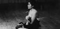 YOKO ONO LOOKING FOR...CURATOR TALK Yoko Ono performing Cut Piece [1964] at Carnegie Recital Hall, NYC. March 25, 1965. Copyright Minoru Niizuma C Yoko Ono  Credit: Yoko Ono performing Cut Piece [1964] at Carnegie Recital Hall