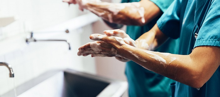 surgical team washing their hands