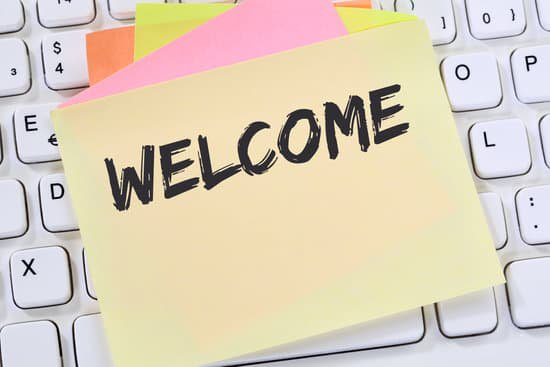post it note saying 'Welcome' on top of a computer keyboard