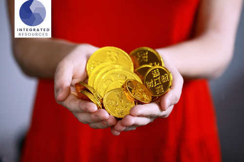 woman holding handful of coins_ https://www.unsplash.com
